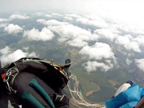 Moment skydiver's parachute got caught in helicopter caught on camera
