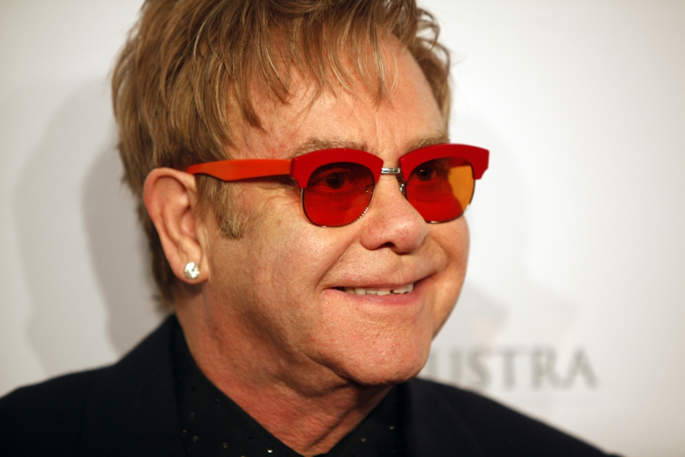 "FILE - In this Oct. 15, 2013 file photo, Elton John arrives at the Elton John AIDS Foundation's 12th Annual ""An Enduring Vision"" benefit gala at Cipriani Wall Street in New York. Tom Hardy will play John in a biopic titled ìRocketman.î  Focus Features announced Hardyís casting as the iconic piano man on Wednesday, Oct. 23, 2013. (Photo by Carlo Allegri/Invision/AP, File)"