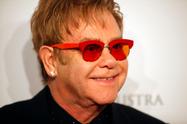 """FILE - In this Oct. 15, 2013 file photo, Elton John arrives at the Elton John AIDS Foundation's 12th Annual """"An Enduring Vision"""" benefit gala at Cipriani Wall Street in New York. Tom Hardy will play John in a biopic titled ìRocketman.î  Focus Features announced Hardyís casting as the iconic piano man on Wednesday, Oct. 23, 2013. (Photo by Carlo Allegri/Invision/AP, File)"""