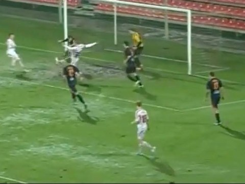 Lithuanian game goes ahead on ludicrously waterlogged pitch – video