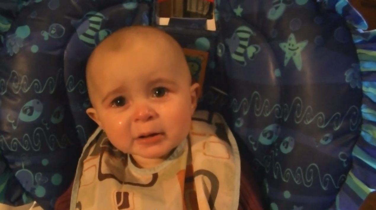 Video: Baby cries as mother sings Rod Stewart song My Heart Can't Tell You No