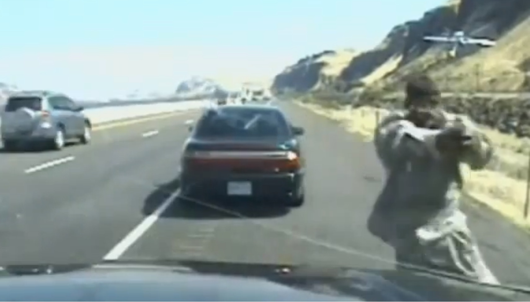John Van Allen II wields his gun at an officer after being pulled over (Picture: YouTube/World News Videos)