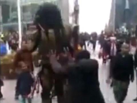 Video: Man pushes Predator street performer on to little girl