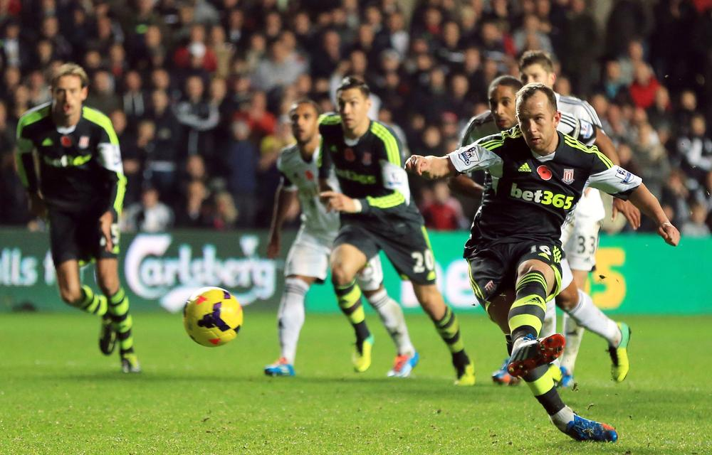 Stoke City's Charlie Adam , right, scores his side's third goal from the penalty spot during their English Premier League soccer match against Swansea City at the Liberty Stadium, Swansea, Wales, Sunday, Nov. 10, 2013. (AP Photo/Nick Potts, PA Wire) UNITED KINGDOM OUT - NO SALES - NO ARCHIVES