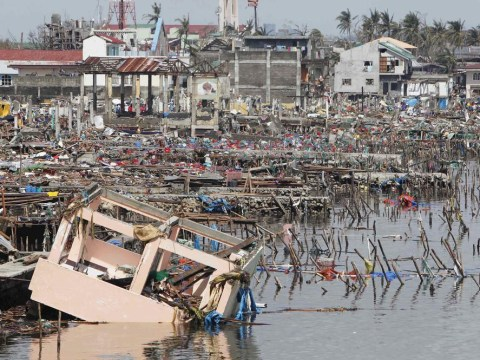 Typhoon Haiyan wipes out homes and schools as 10,000 reported dead in one city alone