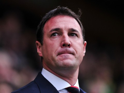 There can only be one winner in the battle between Cardiff City's Malky Mackay and Vincent Tan