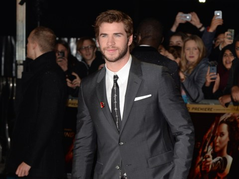 Liam Hemsworth wearing blue, spiked heels is a really weird turn on
