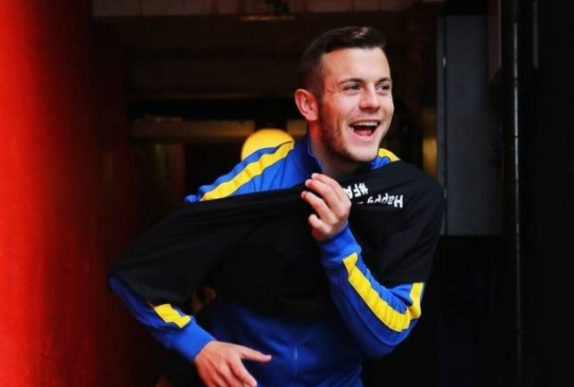 LONDON, ENGLAND - OCTOBER 26:  Jack Wilshere of Arsenal smiles as he walks out for a warm up prior to the Barclays Premier League match between Crystal Palace and Arsenal at Selhurst Park on October 26, 2013 in London, England.  (Photo by Clive Rose/Getty Images)