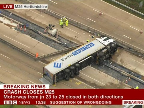 Man arrested for 'dangerous driving' after M25 lorry overturns injuring four people