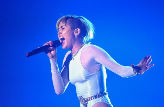 AMSTERDAM, NETHERLANDS - NOVEMBER 10:  Miley Cyrus performs onstage during the MTV EMA's 2013 at the Ziggo Dome on November 10, 2013 in Amsterdam, Netherlands.  (Photo by Gareth Cattermole/Getty Images for MTV)