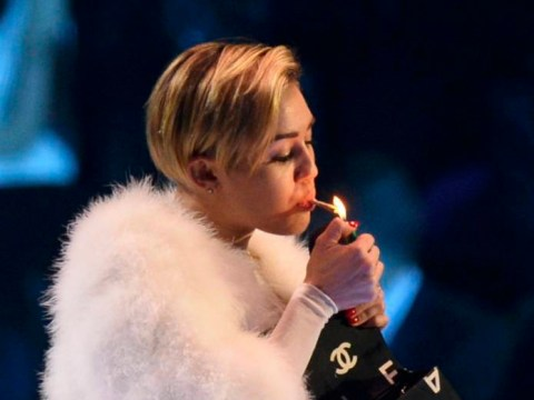 Miley Cyrus shocks yet again as she lets it all hang out and smokes 'joint' on stage at MTV Europe Music Awards