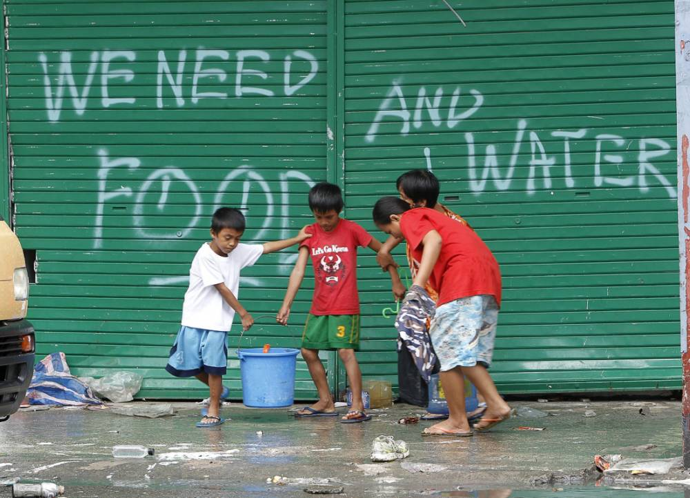 Please help us: Desperate Typhoon Haiyan victims beg for food and water