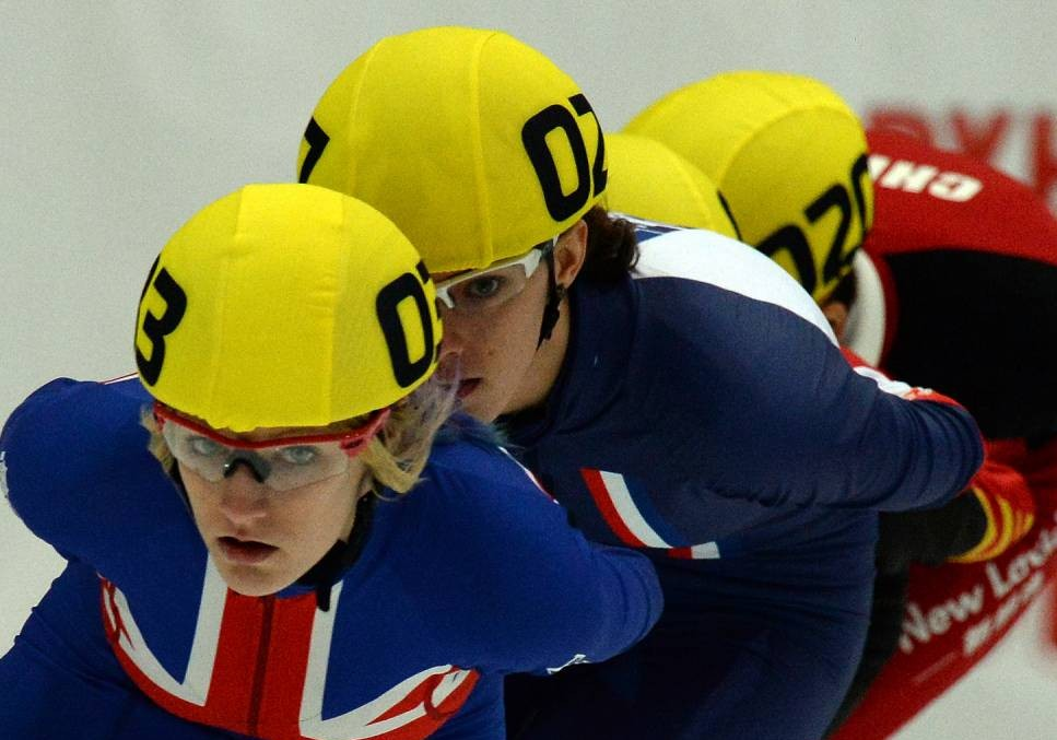 Elise Christie (L) of Great Britain and Veronique Pierron of France compete on November 16, 2013 during the women's 1,500-meter quarterfinal at the ISU World Cup Short Track Speed Skating event in Kolomna, some 100 kms outside Moscow . AFP PHOTO / VASILY MAXIMOVVASILY MAXIMOV/AFP/Getty Images