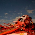 A vehicle sits on a pile of debris from the destruction caused by a tornado that touched down in Washington, Illinois, November 17, 2013. A fast-moving storm system triggered multiple tornadoes on Sunday, killing at least five people, injuring about 40 and flattening large parts of the city of Washington, Illinois as it tore across the Midwest, officials said. REUTERS/Jim Young  (UNITED STATES - Tags: DISASTER ENVIRONMENT TPX IMAGES OF THE DAY)