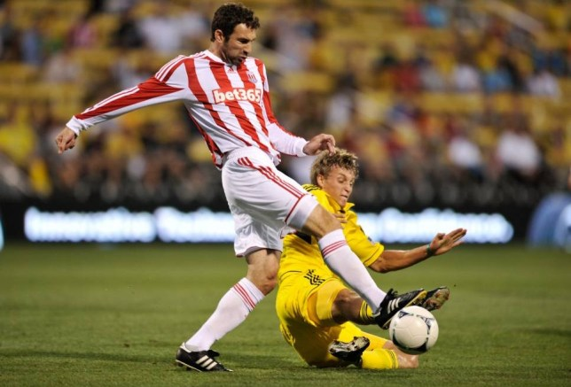 COLUMBUS, OH - JULY 24:  Aaron Schoenfeld #34 of the Columbus Crew slides in to take the ball away from Danny Higginbotham #3 of Stoke City FC in the second half on July 24, 2012 at Crew Stadium in Columbus, Ohio.   (Photo by Jamie Sabau/Getty Images)