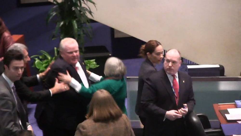 Video: Toronto mayor Rob Ford knocks over female councillor as officials strip him of his powers
