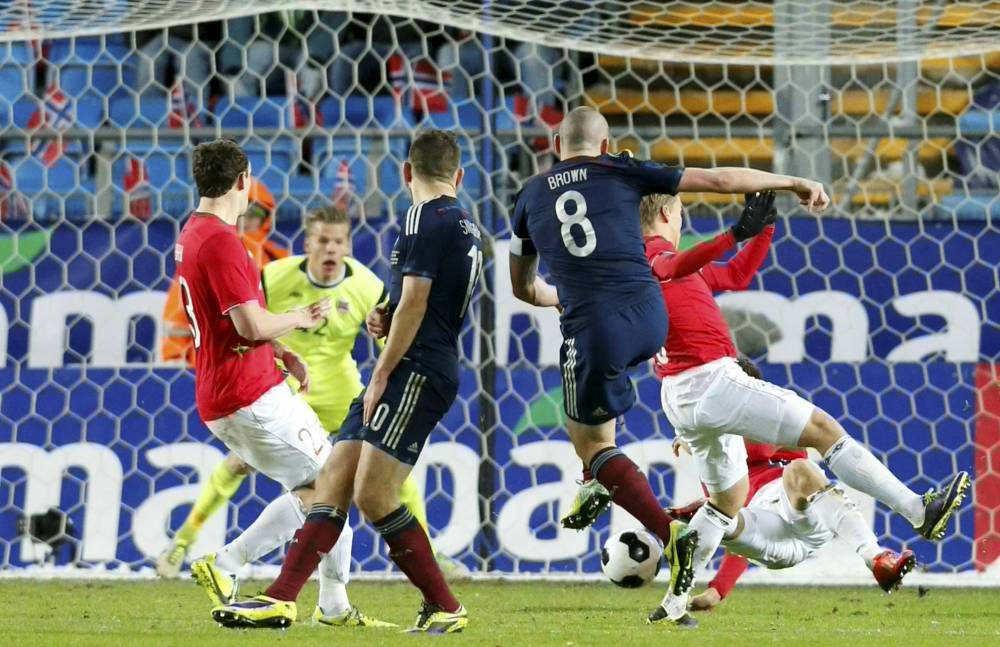 Scotland's Scott Brown, second right, scores his team's first goal during an international friendly soccer match between Scotland and Norway at Aker Stadium in Molde, western Norway, Tuesday, Nov. 19, 2013. (AP Photo/Svein Ove Ekornesvag, NTB Scanpix) NORWAY OUT