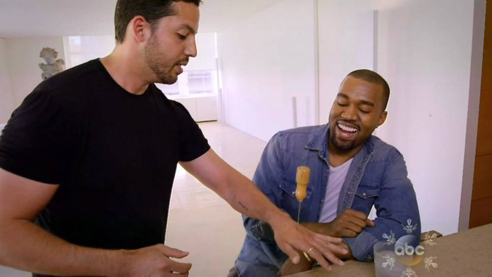 Kanye West watches David Blaine push an ice pick through his hand