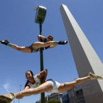 Brazilian participants in the Miss Pole Dance South America 2013 competition perform in in front of the obelisk in Republica Square in downtown Buenos Aires on November 22, 2013 ahead of the contest to be held on November 23 and 25 in the city. AFP PHOTO/Juan MabromataJUAN MABROMATA/AFP/Getty Images
