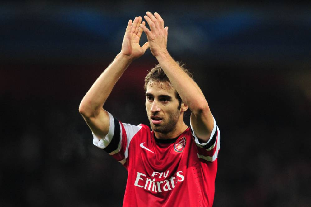 Arsenal's French midfielder Mathieu Flamini applauds to acknowledge the crowd during the UEFA Champions League group F football match between Arsenal and Olympique de Marseille at the Emirates Stadium in London on November 26, 2013. AFP PHOTO / GLYN KIRKGLYN KIRK/AFP/Getty Images