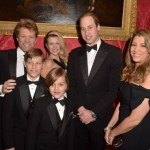 CORRECTING NAME Britain's Prince William, Duke of Cambridge, (2R) poses with US musician Jon Bon Jovi (L), wife Dorothea Hurley (R) and their children Jacob (2L), Stephanie (3L) and Romeo (front, 4L) during the Winter Whites Gala dinner in aid of youth homeless charity Centrepoint at Kensington Palace in London on November 26, 2013.  AFP PHOTO / POOL / DOMINIC LIPINSKIDominic Lipinski/AFP/Getty Images