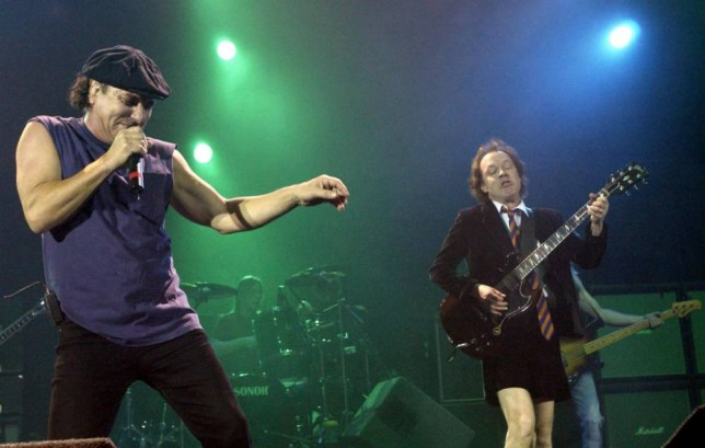 AC/DC's lead singer Brian Johnson (left) and guitarist Angus Young, as the rock giants have become one of the last major bands to agree a deal to have their back catalogue released digitally.   PRESS ASSOCIATION Photo. Issue date: Monday November 19, 2012. The band - famed for tracks such as Back In Black - were among a number of acts who had held back on allowing their music to be sold as downloads through sites such as the iTunes Store. See PA story SHOWBIZ iTunes. Photo credit should read: Yui Mok/PA Wire.   File photo dated 21/10/03.