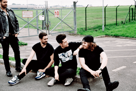 Bastille frontman Dan Smith says it is 'surreal' to be beating Lily Allen and Gary Barlow in chart battle