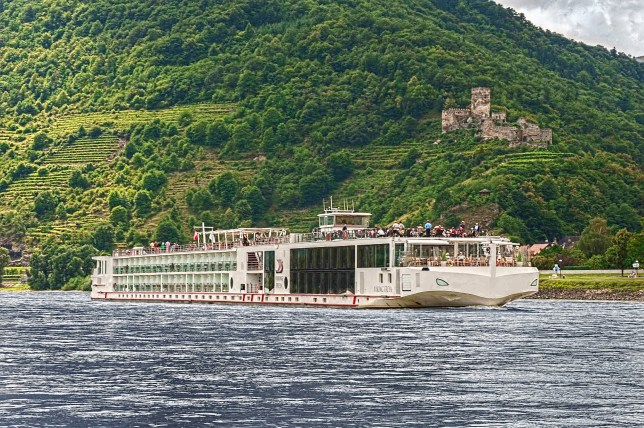 Sailing by... a Viking longship passes the Maus Castle on the Rhine (Picture: Viking River Cruises)