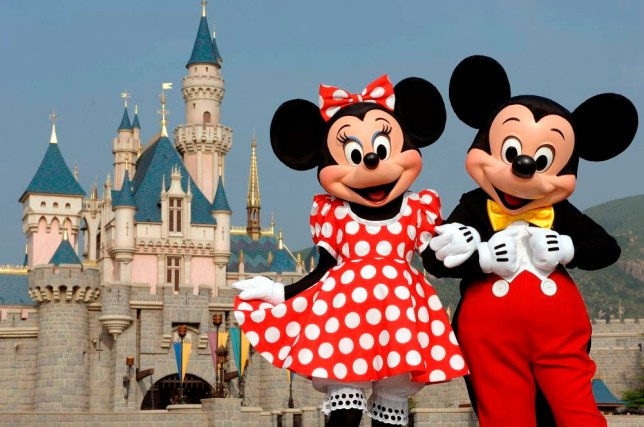 In this photo released by Hong Kong Disneyland, Mickey Mouse and Minnie Mouse pose Thursday, Sept. 1, 2005 in front of the Sleeping Beauty Castle in Hong Kong's Disneyland which is due to open Sept. 12. Intellectuals decried the invasion of American pop culture when the last Disneyland opened in Paris in 1992, but Hong Kong has rolled out the red carpet for Mickey Mouse and Donald Duck. (AP Photo/Hong Kong Disneyland, Mark Ashman, HO)