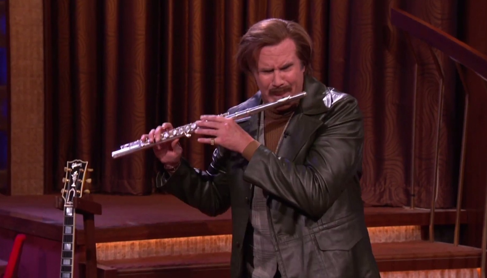 It wouldn't be a Ron Burgundy performance without a jazz flute solo (Picture: Conan O'Brien/YouTube)