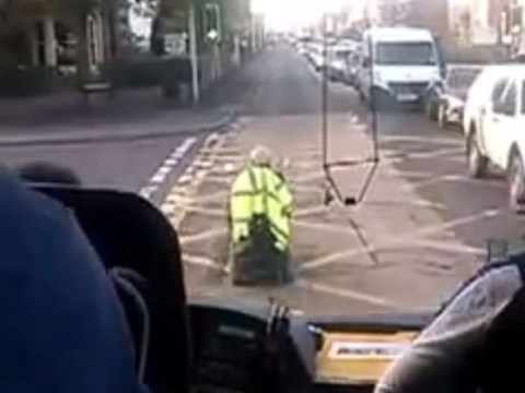 Video: Pensioner on 4mph mobility scooter holds up coach of German tourists