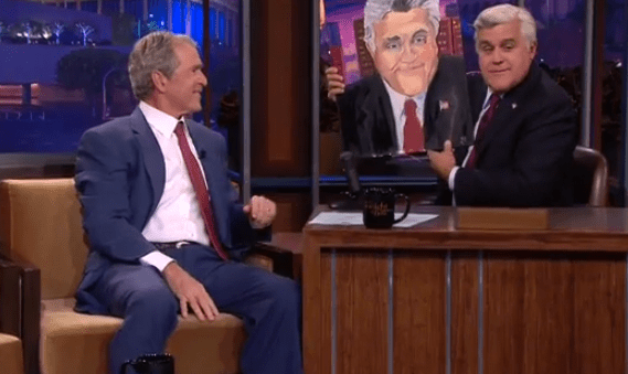 Bush hands the surprisingly accurate painting over to Leno (Picture: YouTube)