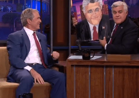 Former US president George W Bush shows off his actually quite good painting of Jay Leno