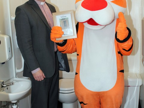 Vicar poses with a tiger in a toilet – but it's all for a good cause