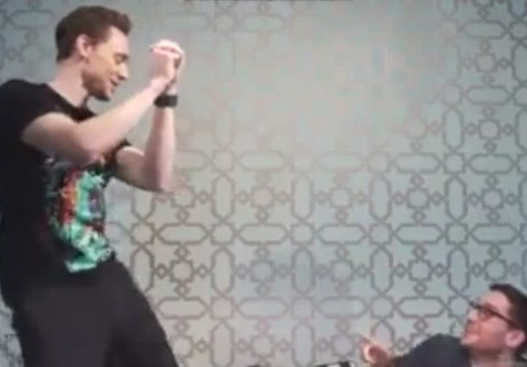 Tom Hiddleston busts a move yet again as he reveals he's seen Chris Hemsworth naked