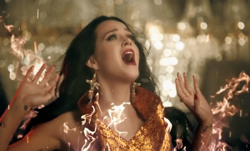 Katy Perry catches fire in the Unconditionally video (Picture: Vevo)