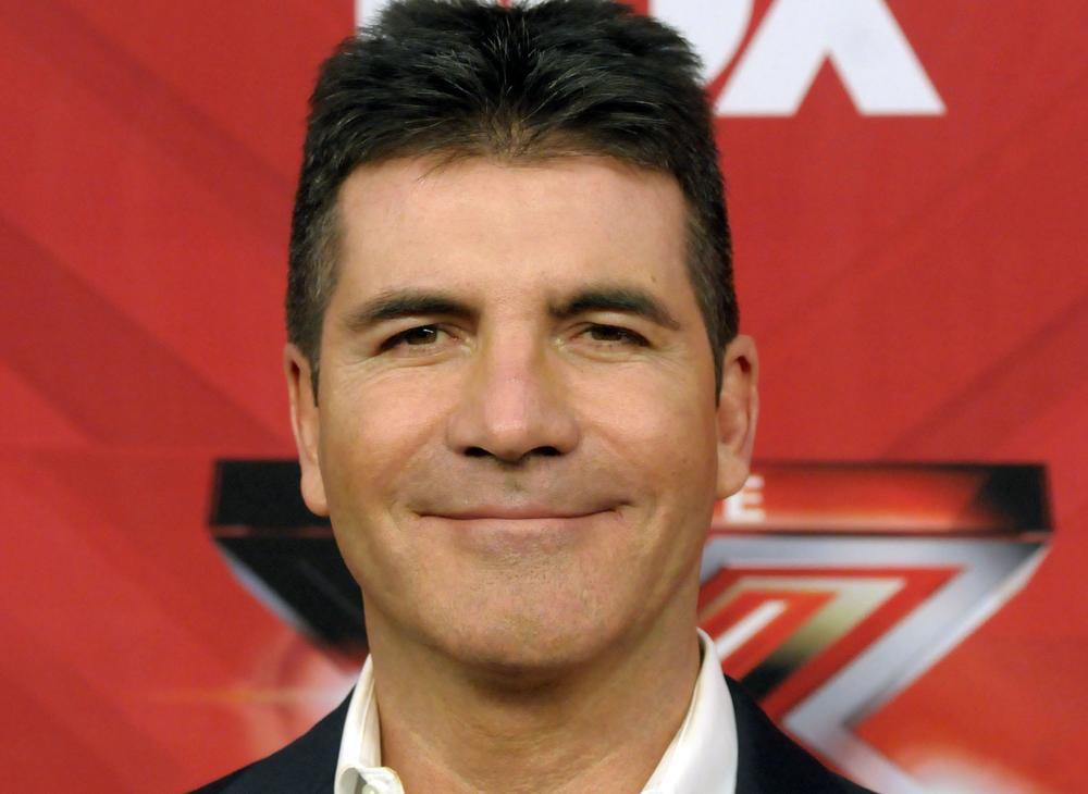 Simon Cowell is a happy bunny (Picture: AP)