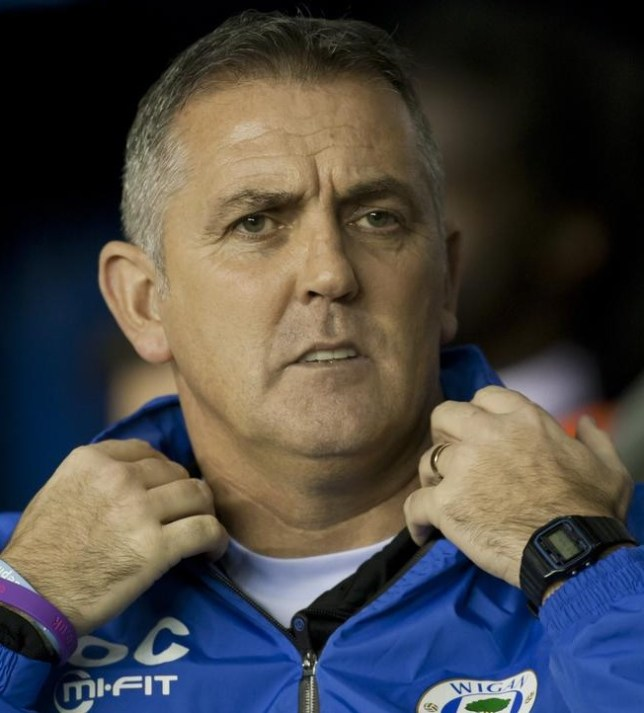 Wigan Athletic's manager Owen Coyle takes to the touchline before his team's Europa League group D soccer match against Zulte-Waregem at The DW Stadium, Wigan, England, Thursday Nov. 28, 2013. (AP Photo/Jon Super) AP Photo/Jon Super