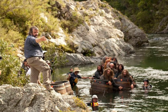 "This image released by Warner Bros. Pictures shows director Peter Jackson, left, during the filming of ""The Hobbit: The Desolation of Smaug."" (AP Photo/Warner Bros. Pictures, James Fisher)"
