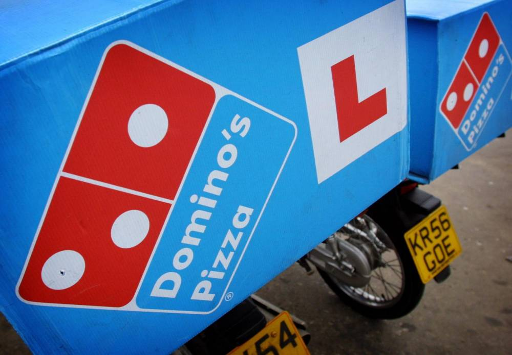 File photo dated 19/2/2007 of Domino's Pizza delivery bikes. More immigrants should be allowed into the UK because Britons do not want to take up jobs at Domino's Pizza, according to the firms's chief executive. PRESS ASSOCIATION Photo. Issue date: Monday December 9, 2013. The pizza delivery chain has 1,000 jobs, including as drivers and cooks, which are unfilled, said Lance Batchelor. See PA story INDUSTRY Dominos. Photo credit should read: Gareth Fuller/PA Wire