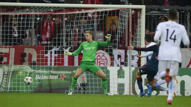 Manchester City's English goalkeeper Joe Hart (L) fails to save Bayern Munich's midfielder Thomas Mueller's goal during the UEFA Champions League group D football match Bayern Munich vs Manchester City in Munich, southern Germany, on December 10, 2013. AFP PHOTO / JOHN MACDOUGALLJOHN MACDOUGALL/AFP/Getty Images