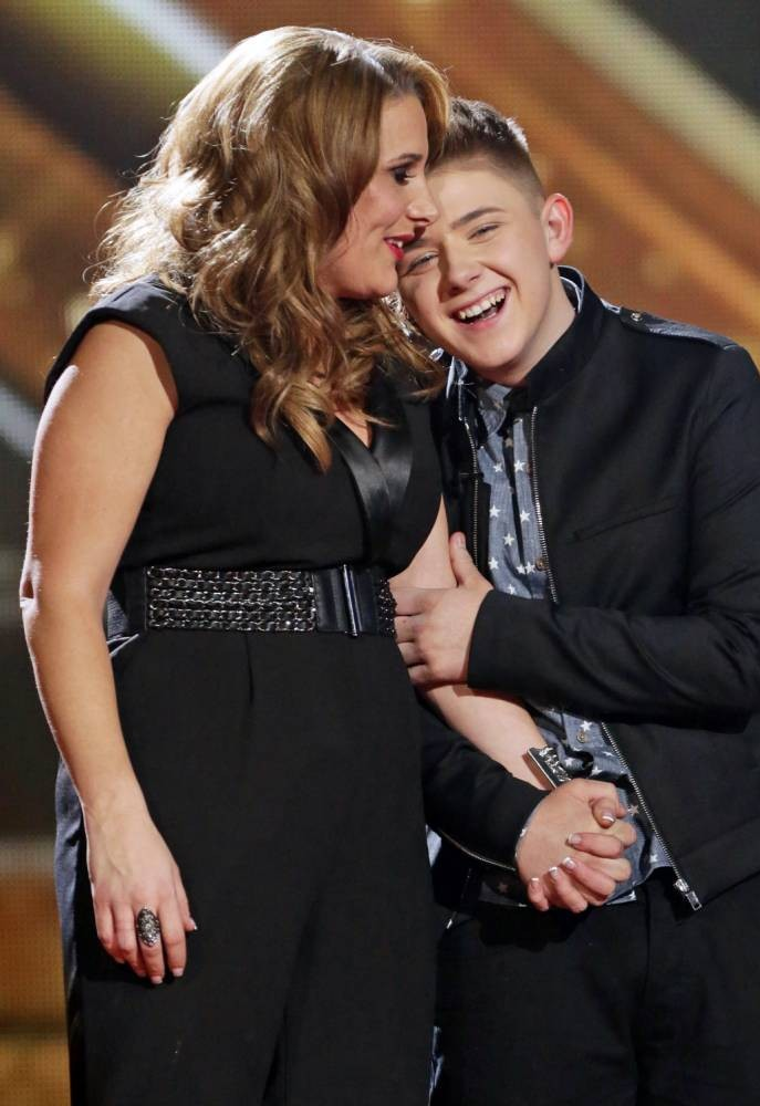 EDITORIAL USE ONLY - NO MERCHANDISING - NO BOOK PUBLISHING   Mandatory Credit: Photo by Tom Dymond/Thames/REX (3428698fd)  Sam Bailey and Nicholas McDonald celebrate reaching the final  'The X Factor' final TV show, Wembley Arena, London, Britain - 14 Dec 2013