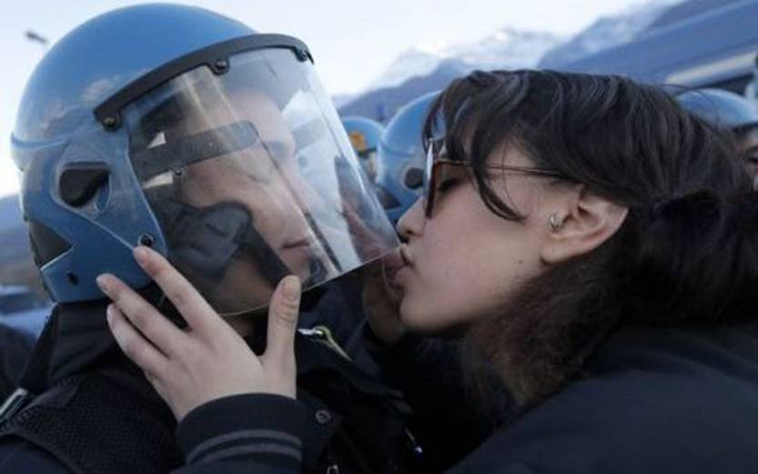Protester faces sexual assault charge after kissing riot policeman