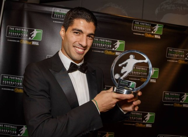 Handout photo dated 16/12/2013 provided by William Hill. The Football Supporters Federation Awards Night at the  Emirates Stadium the home of Arsenal Football Club. Player of the year Luis Suarez. Issue date: Monday December 16, 2013. Photo credit should read: Steve Welsh/William Hill/PA Wire. NOTE TO EDITORS: This handout photo may only be used in for editorial reporting purposes for the contemporaneous illustration of events, things or the people in the image or facts mentioned in the caption. Reuse of the picture may require further permission from the copyright holder.