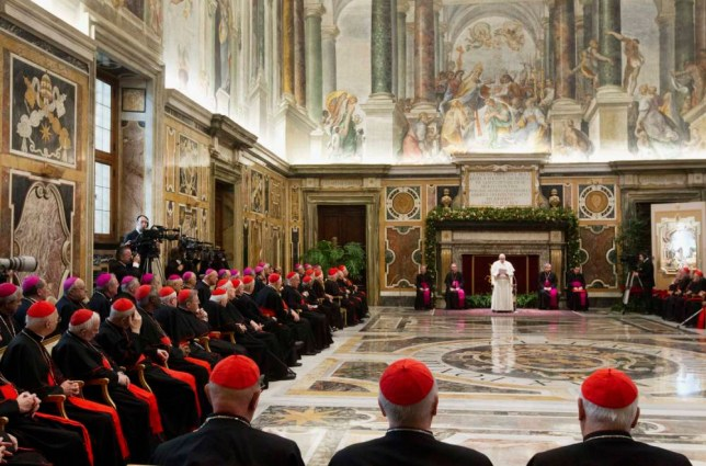 Pope Francis leads an audience for Christmas greetings to the Curia in the Clementina hall at the Vatican December 21, 2013. REUTERS/Claudio Peri/Pool  (VATICAN - Tags: RELIGION)