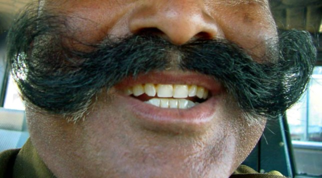 Man refused entry into country 'because he refused to shave off his moustache'