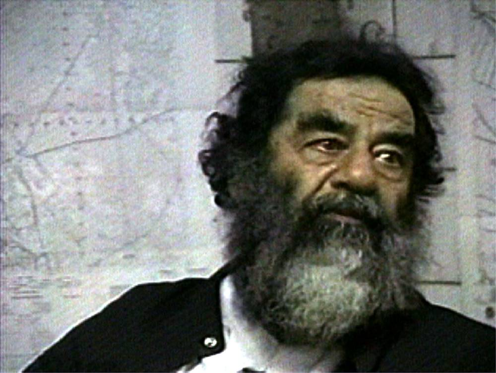 Ten years after Saddam Hussein's capture, Iraq struggles with violent legacy
