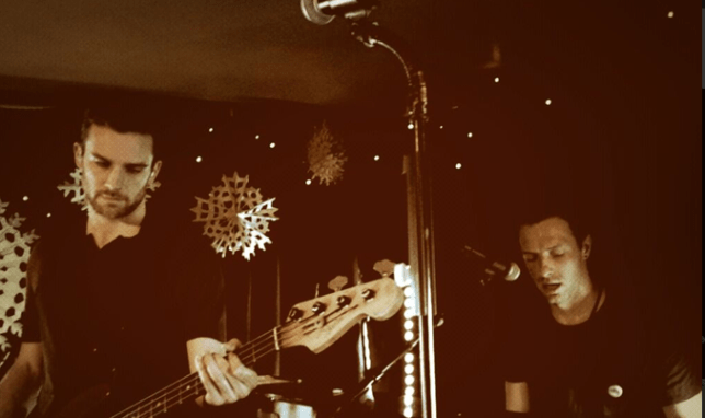 Coldplay's Chris Martin and Guy Berryman at a secret gig at a pub in Somerset (Picture: Parlaphone/Twitter)