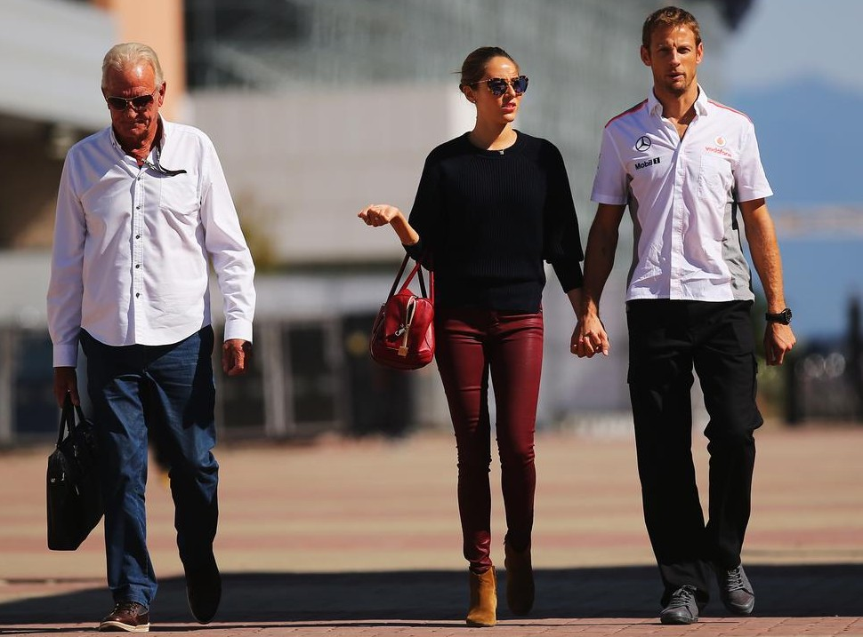 YEONGAM-GUN, SOUTH KOREA - OCTOBER 03: Jenson Button of Great Britain and McLaren and his girlfriend Jessica Michibata and his father John Button arrive in the paddock during previews for the Korean Formula One Grand Prix at Korea International Circuit on October 3, 2013 in Yeongam-gun, South Korea. Clive Rose/Getty Images