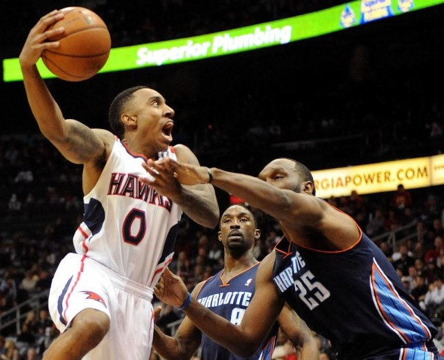 Jeff Teague, left, in action for the Atlanta Hawks (Picture: AP)